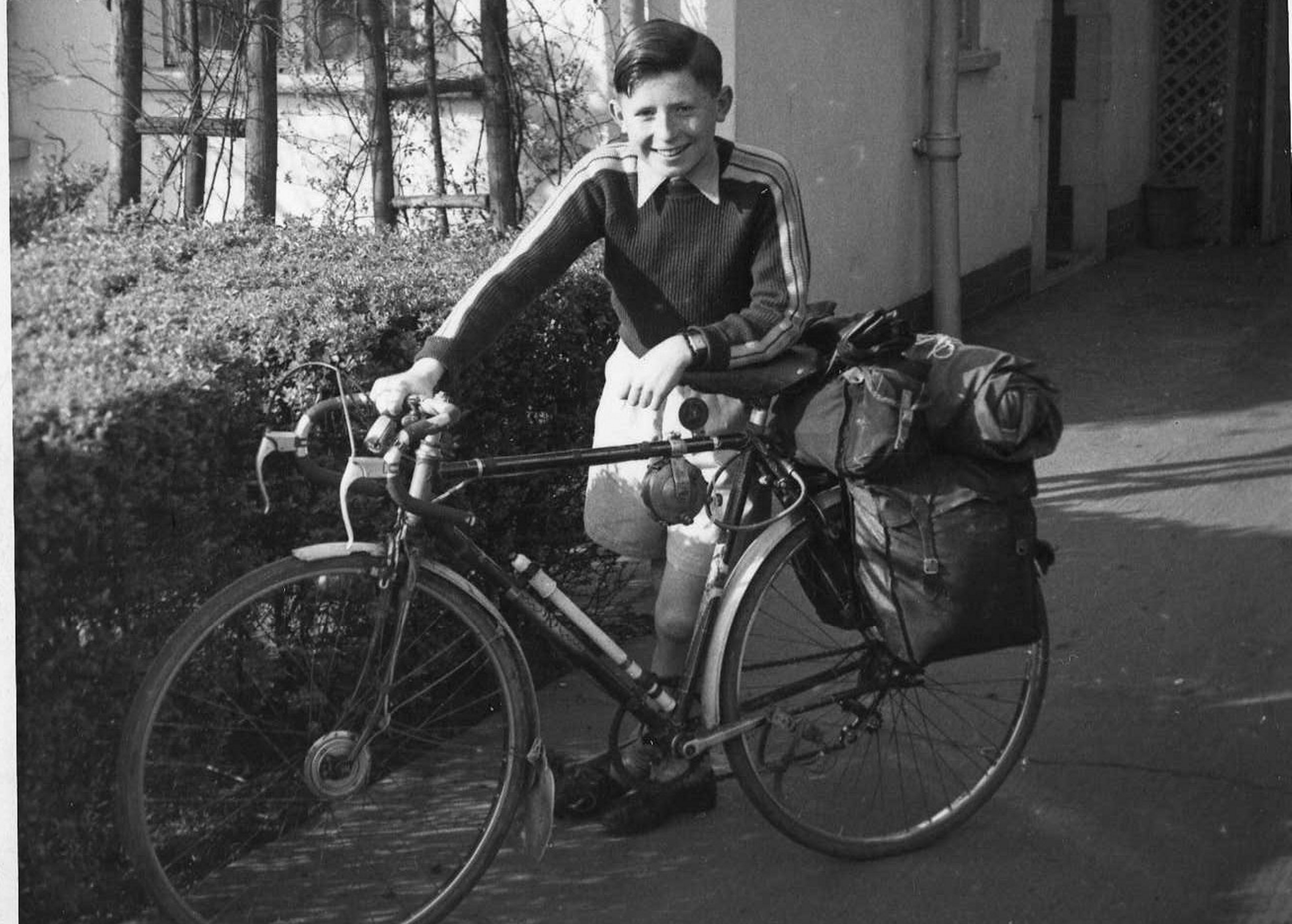 Everything bar the kitchen sink. Graham about to set off on an Easter camping trip to Wormhill, Derbyshire, in around 1956 or 1957. The Doncaster Schools Cycling Proficiency badge can be seen on the crossbar, underneath the saddle.
